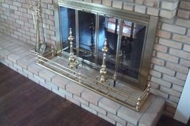Brass fireplace tools and fender.