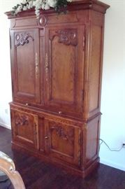 Oak breakfront/cupboard with hand carved accents and pull out writing shelf.
