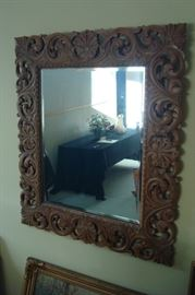 Hand carved wall mirror.