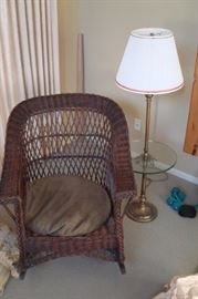 Wicker chair and floor lamp.