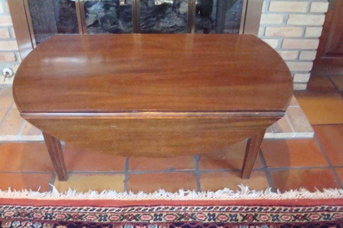 Mahogany drop leaf coffee table.