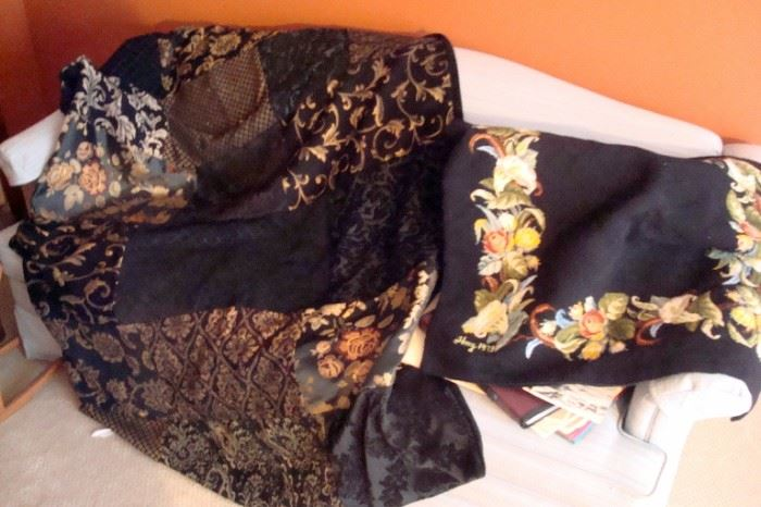 Antique buggy robe and needlepoint throw.