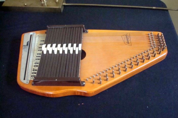 Auto harp and case by Oscar Schmidt.