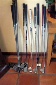 Set Taylor Made Super steel golf clubs and several putters including Odyssey, Acuity & etc. Not shown, golf bag & etc.