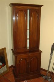 Solid cherry china cupboard with grooved plate shelves.