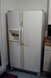 Amana refrigerator/freezer with ice maker.