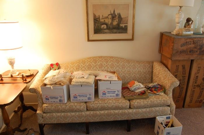 nice sofa, boxes of vintage linens