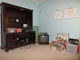 large entertainment center, stereo turntable, VCR's, small TV, CD's, DVD's
