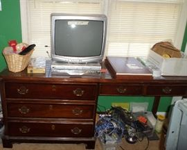 one of many desks available, DVD player & another small TV
