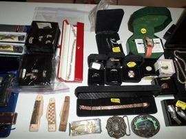some pocket knives, belt buckles & small bit of the sterling jewelry