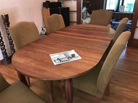 Crate and Barrel Dining Room table and 6 chairs.  Shown with 2 leaves, another leave is available.  2 captains chairs and 4 regular chairs.
