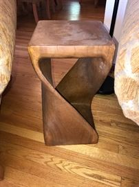 There is a pair of these beautiful burl tables