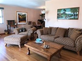 Living room set with special attention to the coffee table made with wood from the bridge at Royal Gorge in Colorado
