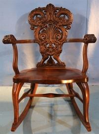 123a  Mahogany heavily carved rocker attrib. to Horner, 33 in. T, 25 in. W, 17 in. D.