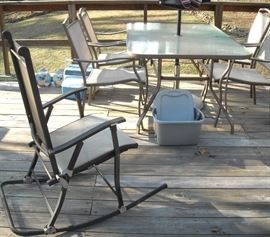 Nice patio table, chairs, umbrella and rocker