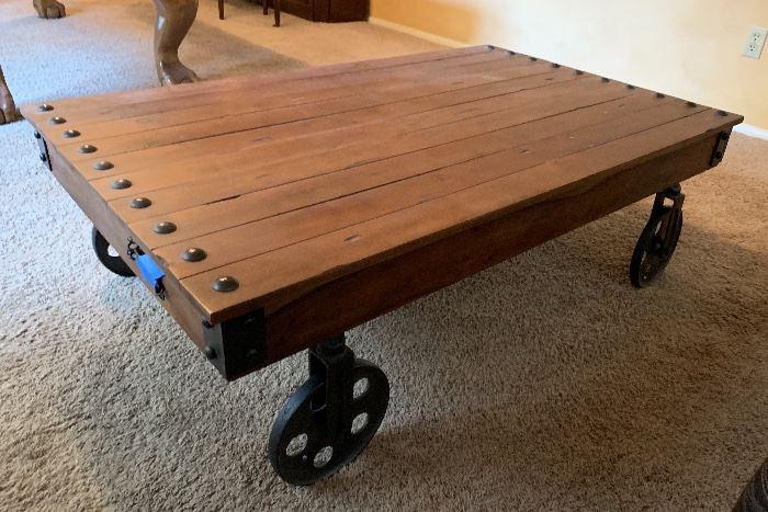 World Market Metal Wheel Coffee Table15x30x48inHxWxD