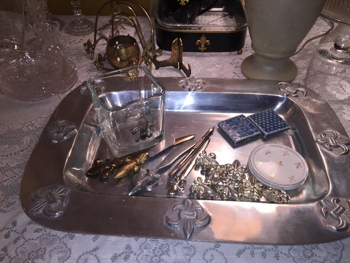 so much Mardi Gras including Fleur delis  trays, knives, picks, barware, candles etc.  Perfect as gifts--