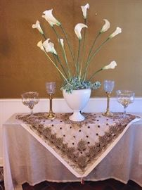 glamourous entrance table and flowers--lots of silk flower arrangements