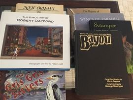 many coffee table Louisiana books plus we have stacks of gorgeous books--cases filled