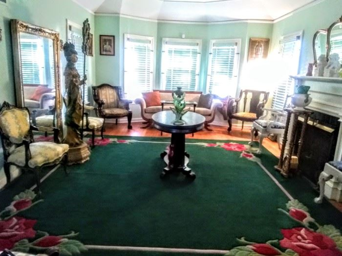Beautiful view of Formal Living Room with it's very lovely wall color, geometric  ceiling, and deep emerald green rug, truly ,accenuates the entire room of beautiful furniture and decor.