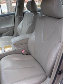 2007 Toyota Camry LXE, four-door sedan with sunroof, honey/gold. 98,xxx miles. FWD, 4 cyl. 2.2-liter engine, traction control. AC, power windows & door locks, cruise control, power steering, tilt wheel, AM/FM stereo, cassette, CD/MP3, JBL. Premium Sound, Bluetooth wireless, dual leather power seats, moon roof, alloy wheels. There are some scratches and dents in the fender areas. Car has been serviced regularly. Older lady drove the car, well maintained, has a dent in front fender and small scrape on the back fender. Inside is clean and in good shape. Come to the sale, see, leave a bid or buy at the asking price.Several more photos follow.