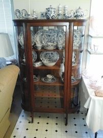 Antique  oak china cabinet with curved glass.