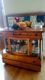 Beautiful unusual and hard to find antique buffet with curved glass.