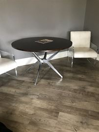 "Restoratian 48"" table and lucite chairs two available."