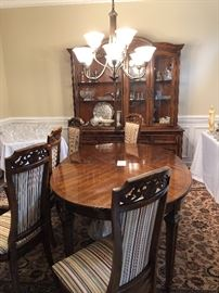 Dining set 96 inches , with 6 chairs and China Caninet $1,200. Pieces are sold separately.