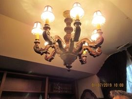 ONE OF 2 WOODEN ANTIQUE CARVED CHANDELIERS