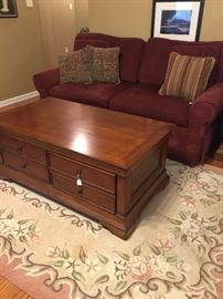 Love seat in great condition and cool coffee table.