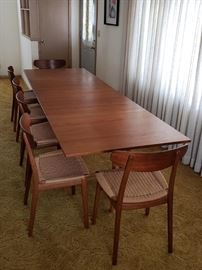 Mathsson table with Hansen chairs. Please note that the table has some sun fading on the drop leaves. Table in very good condition but not mint.