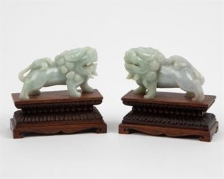Lot 86: Chinese Carved Pale-Green Jadeite Jade Foo Dogs, 20th c.