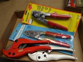 Lot of crimpers,  pvc pipe cutters.
