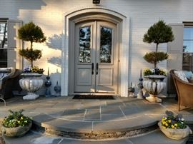 Front entry, with vintage zinc lightning rods, pair of concrete planters, with lion heads and pansies.
