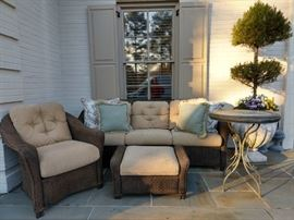 Very comfy grouping of outdoor rattan furniture, by Lloyd Looms.