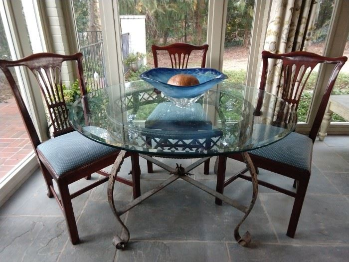 Very sturdy wrought iron/beveled glass dining table, with set of four vintage mahogany side chairs.