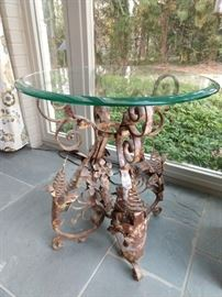 LOVE all the curlicues on this perfectly aged wrought iron table, with beveled edge glass top!