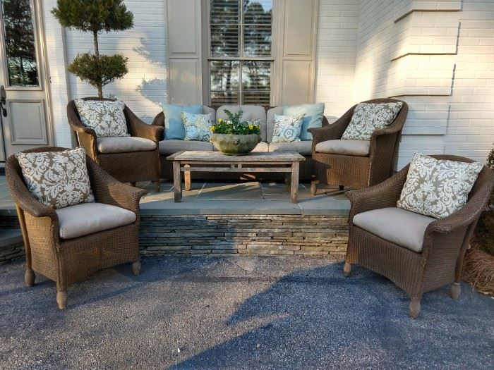 Another grouping of all-weather wicker, by Lloyd Looms furniture, with Smith & Hawken teak coffee table.