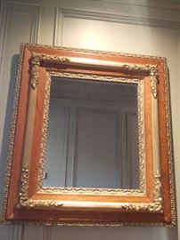 One of a pair of oak/gilt wood wall mirrors.