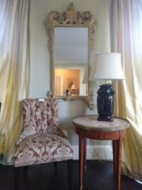 Nicely upholstered side chair, vintage bouillotte table, Asian porcelain table lamp and John Richard wall mirror.