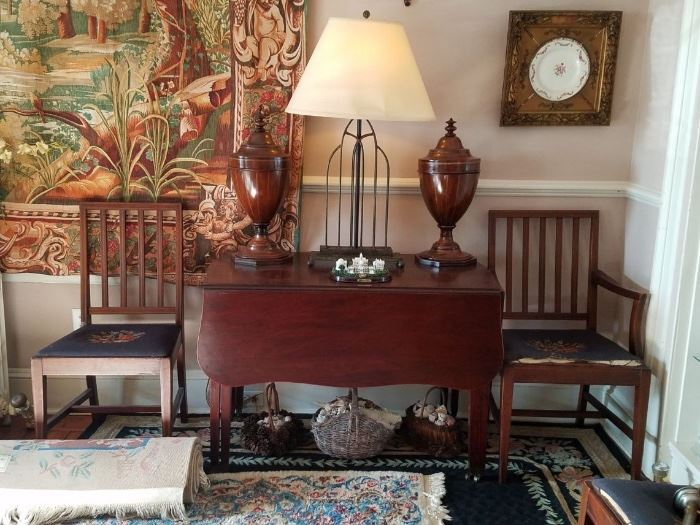 Mahogany drop leaf table with four chairs.
