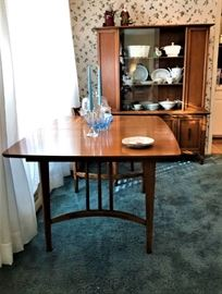 midcentury dining table with six chairs and extra leaf.