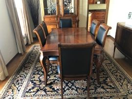 Raylen Vineyards Dining Set with Pads. 2 Leaves and 8 Leather Covered Chairs
