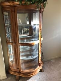 Large lighted curio cabinet with glass shelves