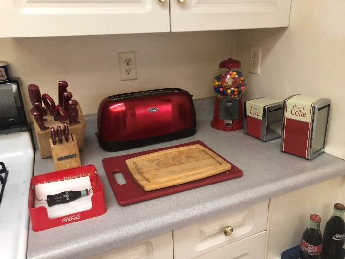 4 slice red toaster 15.00  knife set 10.00  gum ball machine 25.00  napkin holders $$