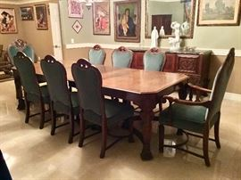 Ten foot long carved wood table with 8 upholstered and wood chairs