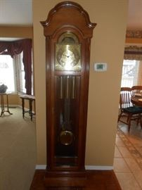 Grandfather clock, wood with instructions at desk