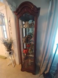 Mahogany curio cabinet this cabinet is a great size lights up has a mirrored back and adjustable shelves $120