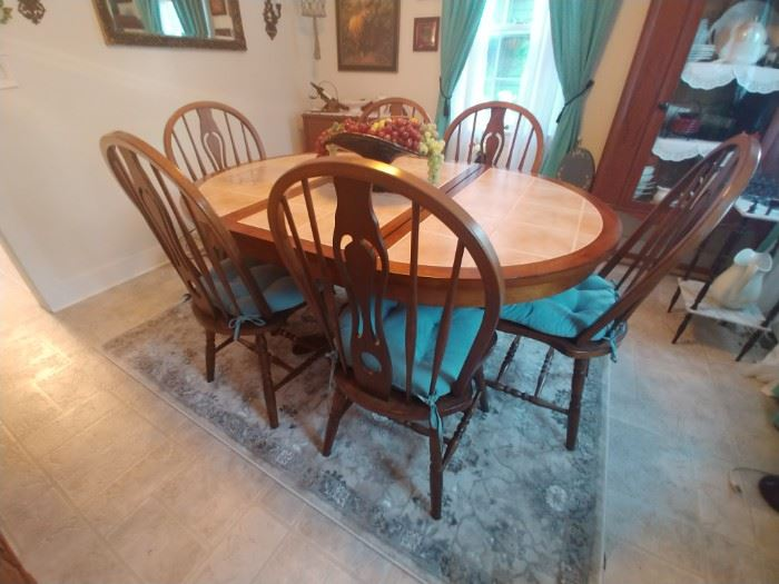 Double pedestal tile top table with pop up leaf and six solid bow back chairs $250